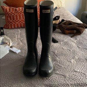 Slightly worn black hunter rain boots size 8.5